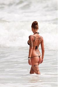 TopRq.com search results: tattoo girl on the beach in the sea