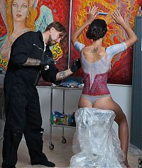 Art & Creativity: body art girl with a dirndl oktoberfest dress