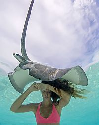 Mermaid and the stingray underwater photography by Christian Coulombe
