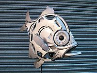 Hubcap sculpture creatures by Ptolemy Elrington