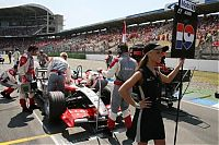 TopRq.com search results: Grid Girl Christijan Albers Midland Mf1 Hockenheim 2006-07-30