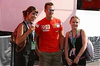 TopRq.com search results: Michael Schumacher Ferrari Posing With Some Girls In The Paddock Magny Cours 2006-07-15