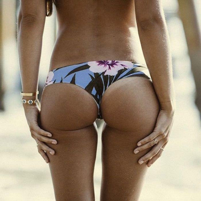 Woman nice butt black bikini showing stock photo