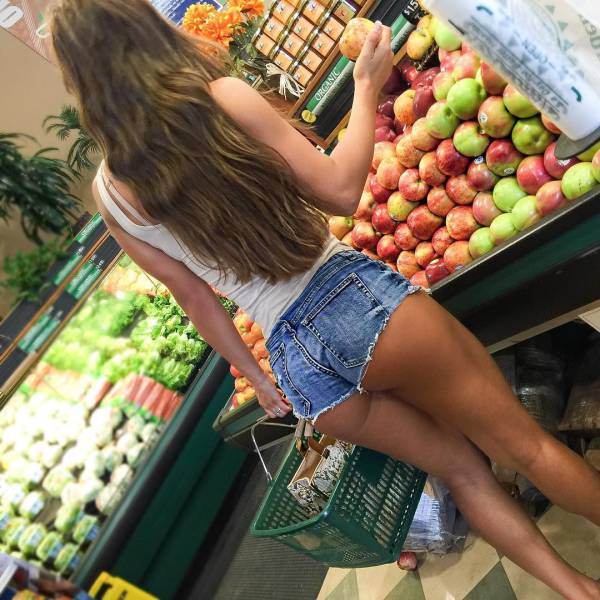 young girl in jean shorts