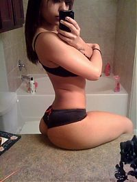 TopRq.com search results: young teen girl taking pictures in a mirror with iphone