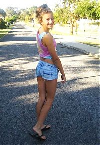 People & Humanity: young girl in jean shorts