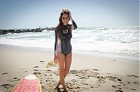 Sport and Fitness: young surfing girl